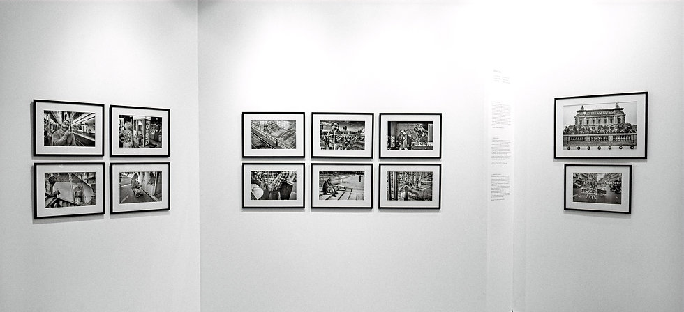 photography exhibition by laurent delhourme at the grand palais in paris in 2019. street photographs in black and white. presented in black photo frames. Fine art