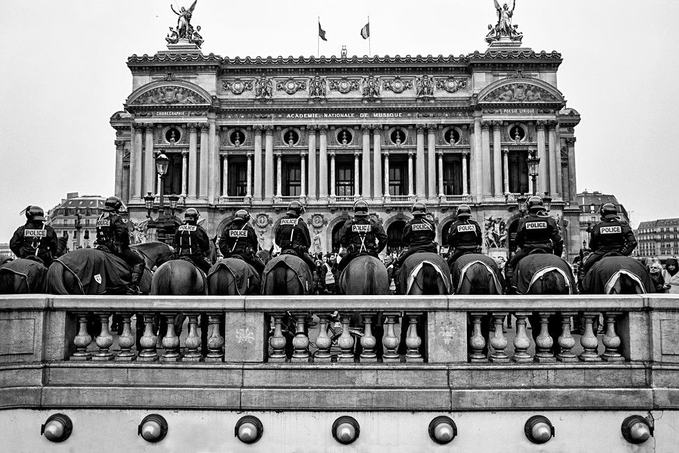 the horses of the Garnier Opera during a demonstration of yellow vests in Paris, black and white photo by Laurent Delhourme photographer