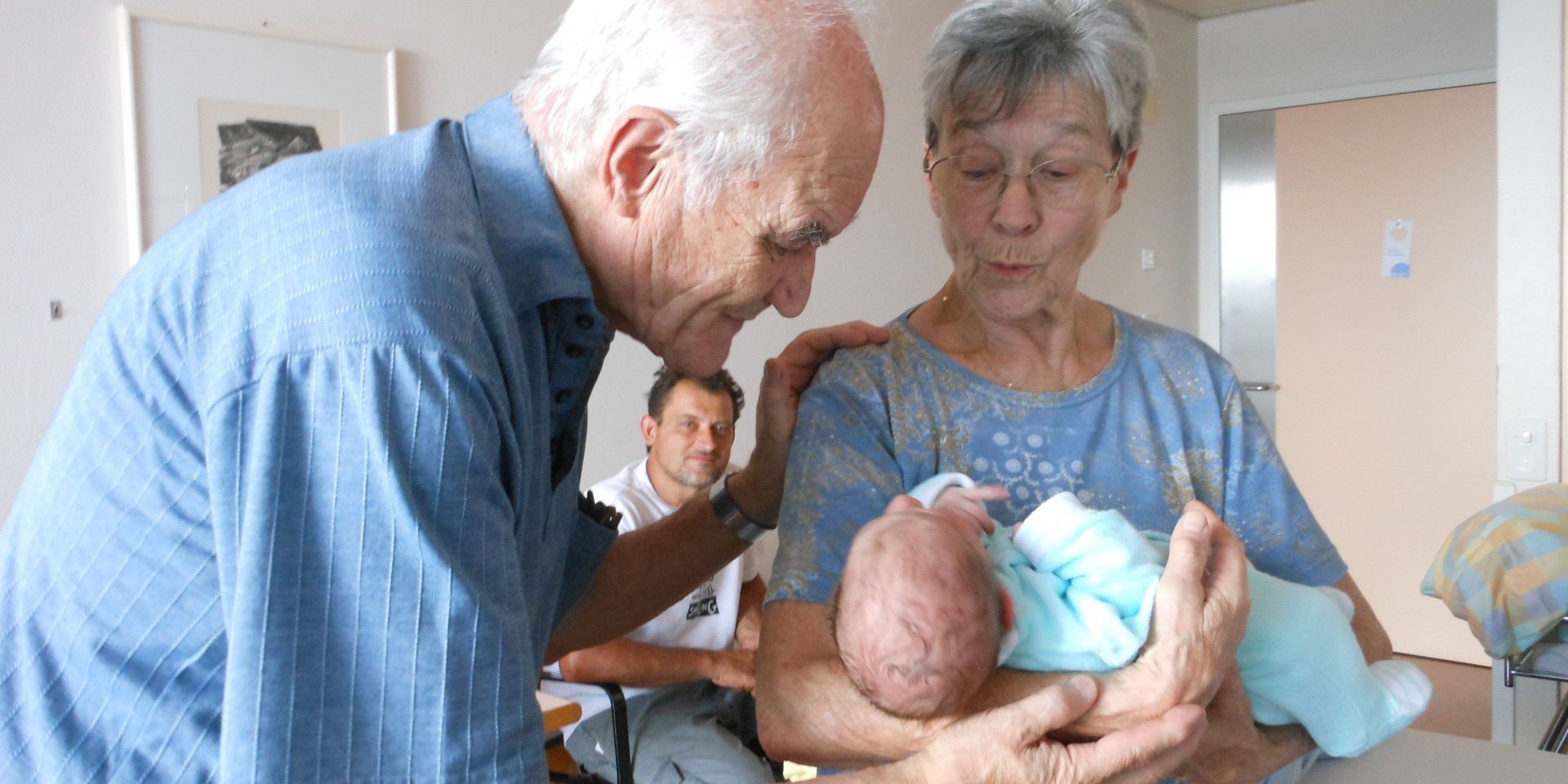 newborn with grandparents