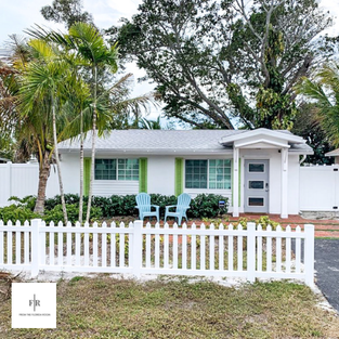 White picket fence gives a Key West style beach cottage feel