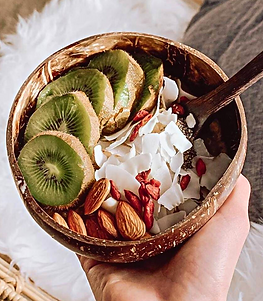 Coconut bowl and spoon, full of nuts and fruits