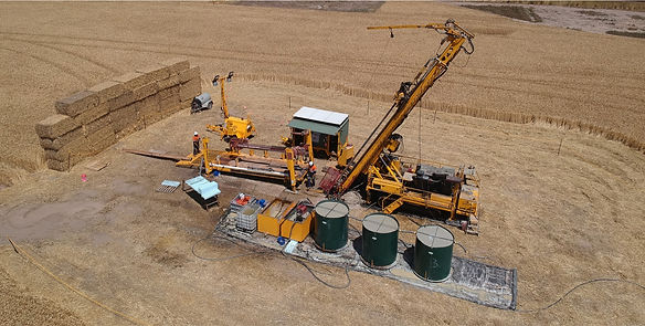 Drill rig with hay bales.jpg