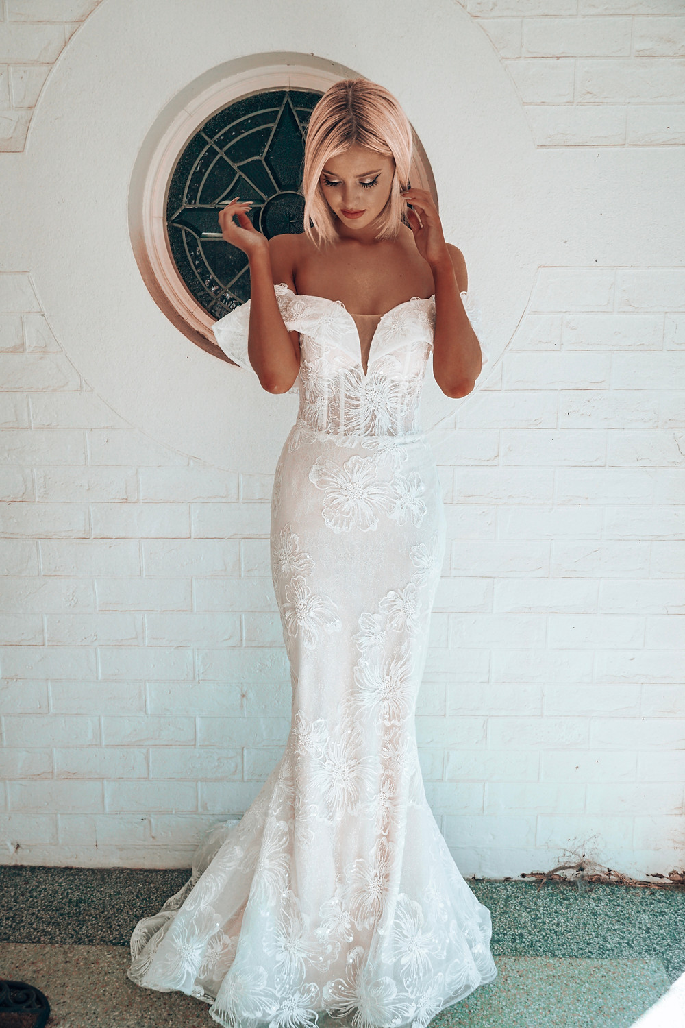 Chloe by Rachel Rose. Wedding dress suggestion for hourglass shaped bride. Off shoulder mermaid cut with floral detail.