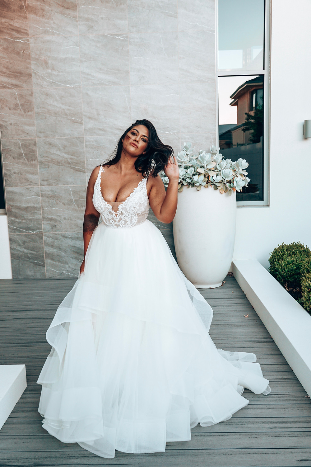 Cloud by Rachel Rose. Wedding dress suggestion for pear / triangle shaped bride. Layered tulle skirt ballgown with embroidery detail bodice.