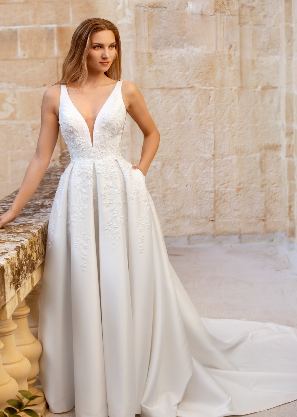 Imperial Topaz by Dando London. Wedding dress suggestion for tall bride. Mikado ballgown with box pleats and deep v-neckline.