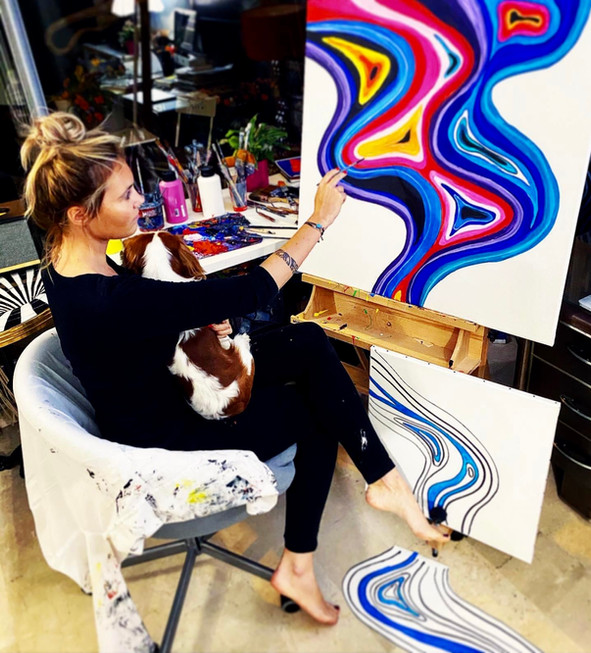 Artist Kate Wyrembelska working at her studio