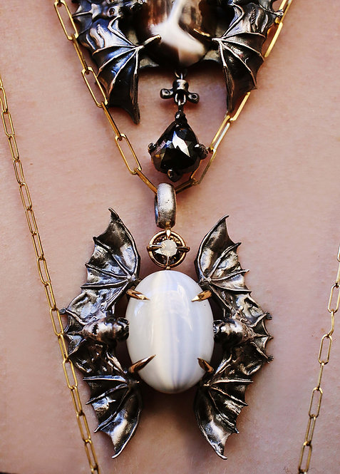 Bat Necklace with Green Diamond