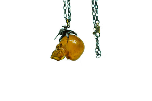 Amber Skull Pendant with Dragon and Eagle Claw