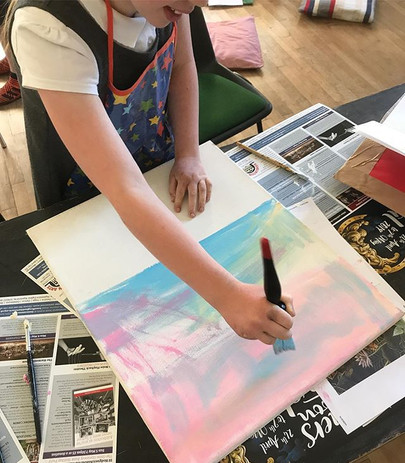 Painting backgrounds at Art club in Ashb