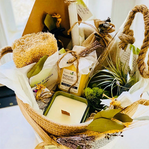 Basket with beauty products and terrarium inside