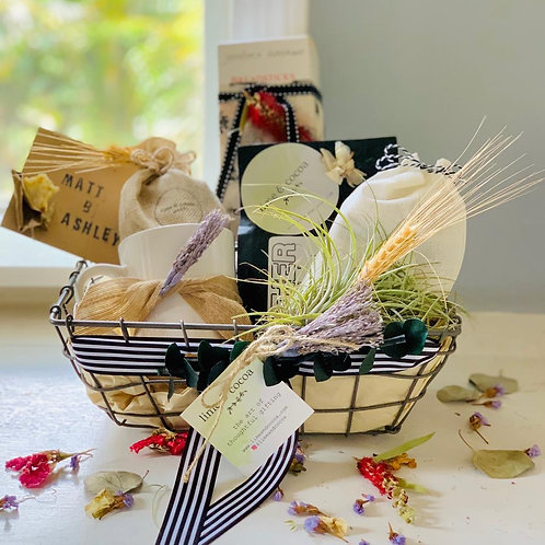 basket with coffee, breadsticks, driftwood and air plant