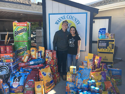 Man woman donating food and supplies to Wayne County Humane Society
