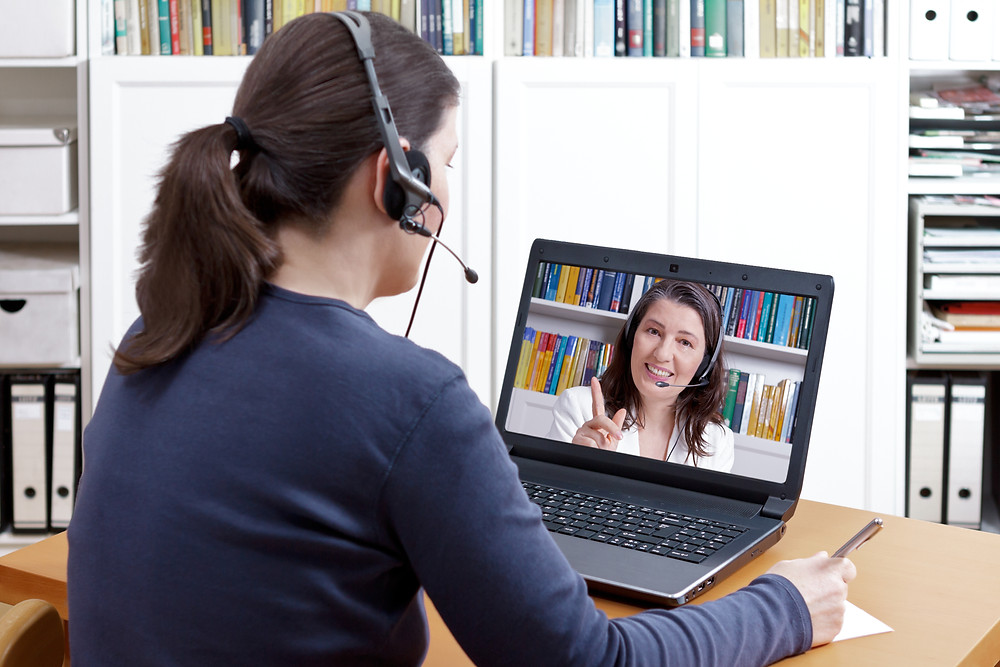 A student speaks to her online tutor