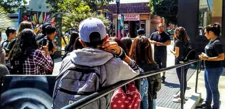 Artist Bud Herrera lecturing Santa Ana Xqamerica students