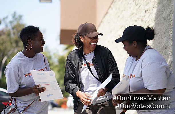 Three Black Women with voter registration forms in hand.