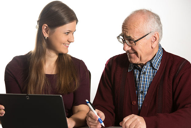 Young Adults helping senior with technology