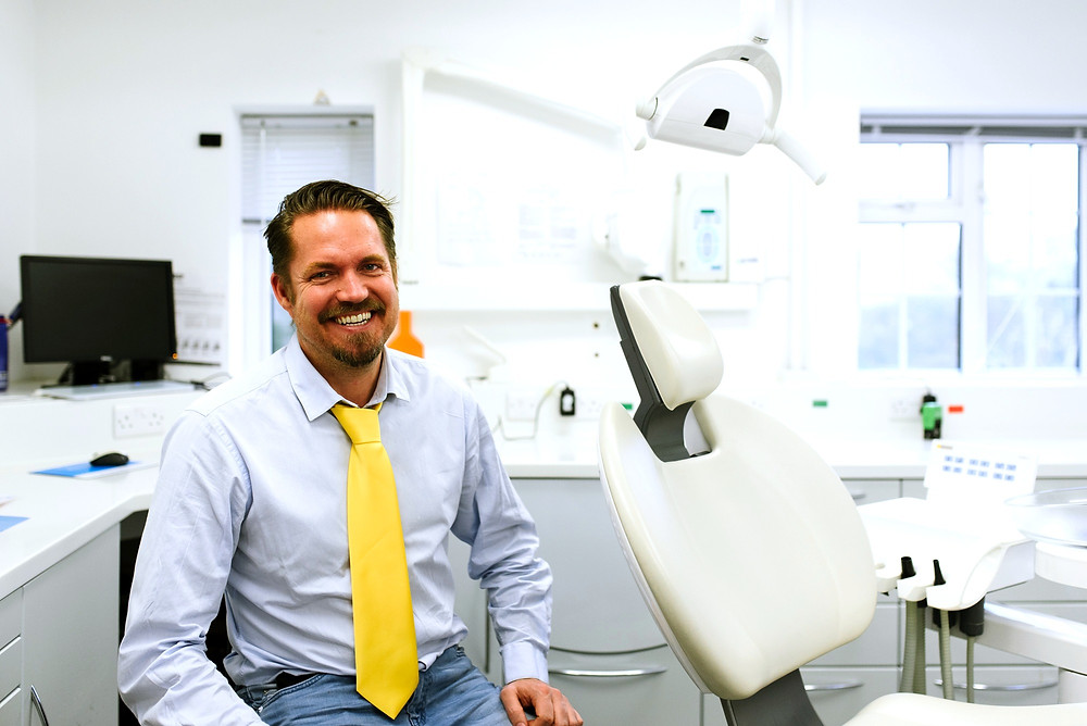 Male Dentist in surgery