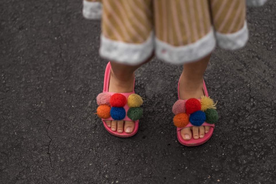 pom pom colourful shoes, child's feet