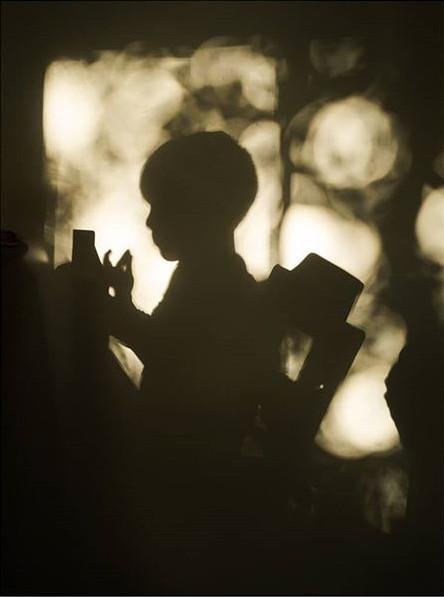 Boy shadow eating toast