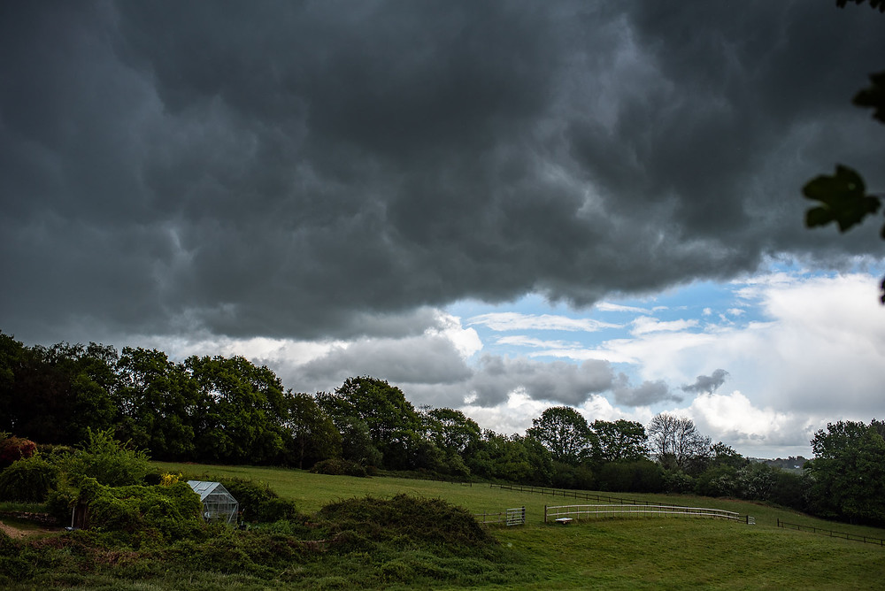 Storm clouds over countryside in east sussex