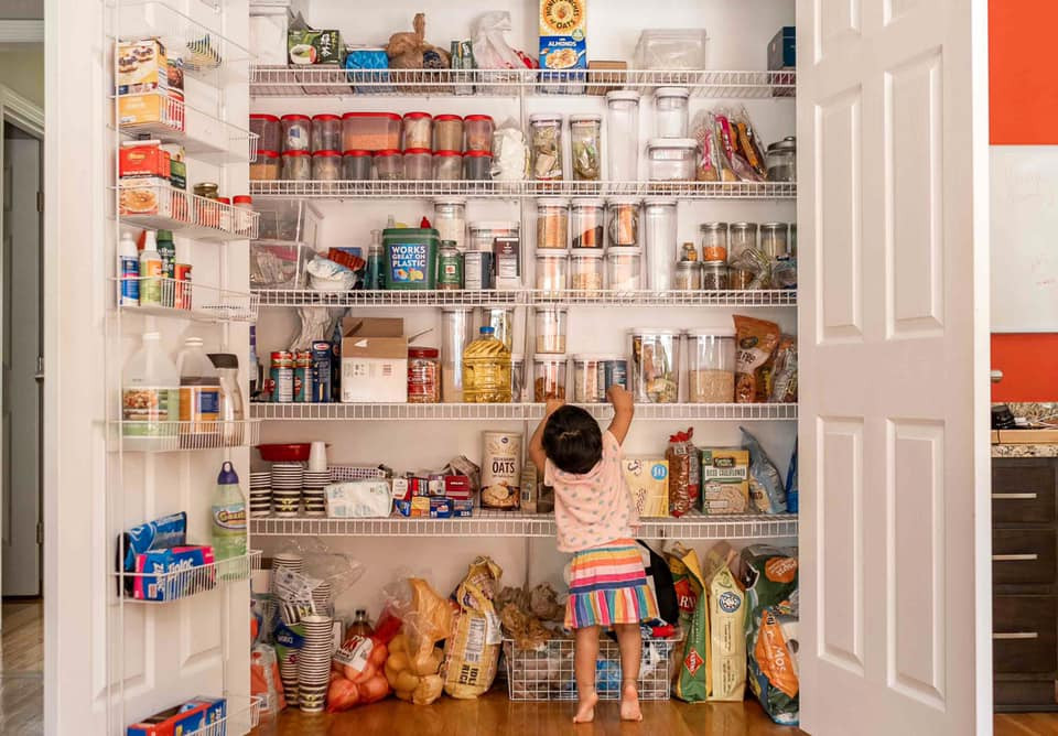 child in pantry cupboard