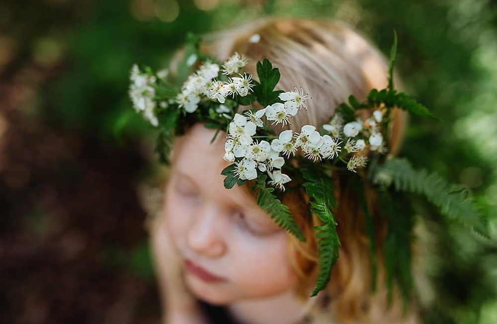 Girl in forest with flower crown
