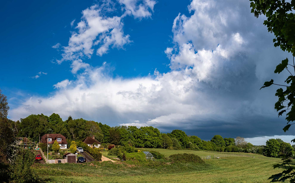 blue skies and retreating storm clouds near Crowborough, East Sussex, border with Kent