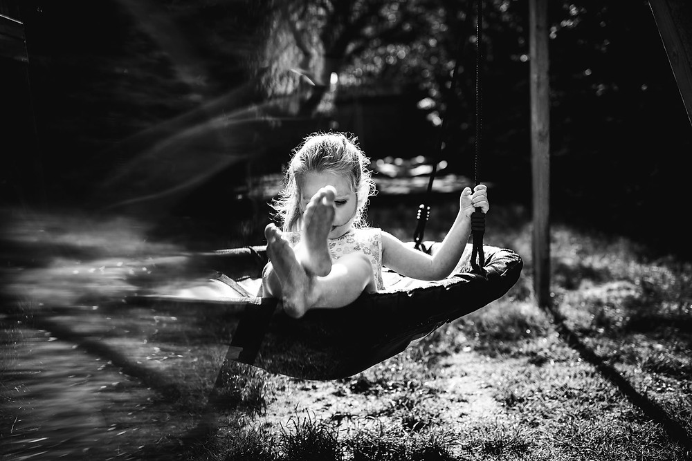 girl on swing in black & white