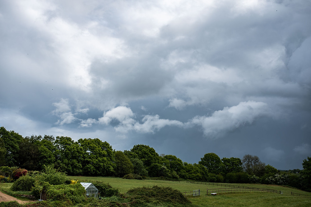 grey clouds over countryside in uckfield