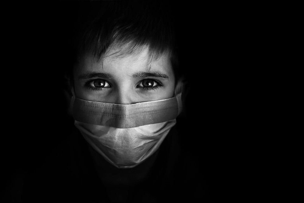 Boy in surgical face mask