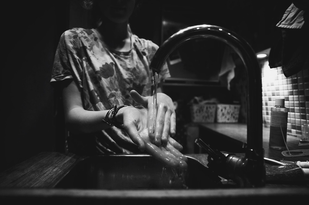 Washing Hands under a tap in black & white