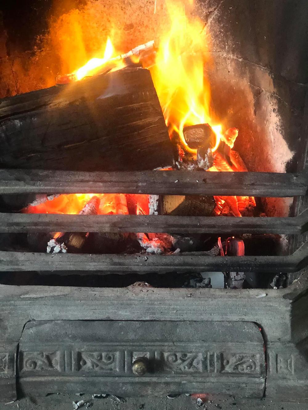 Orange flames in a cast iron fire