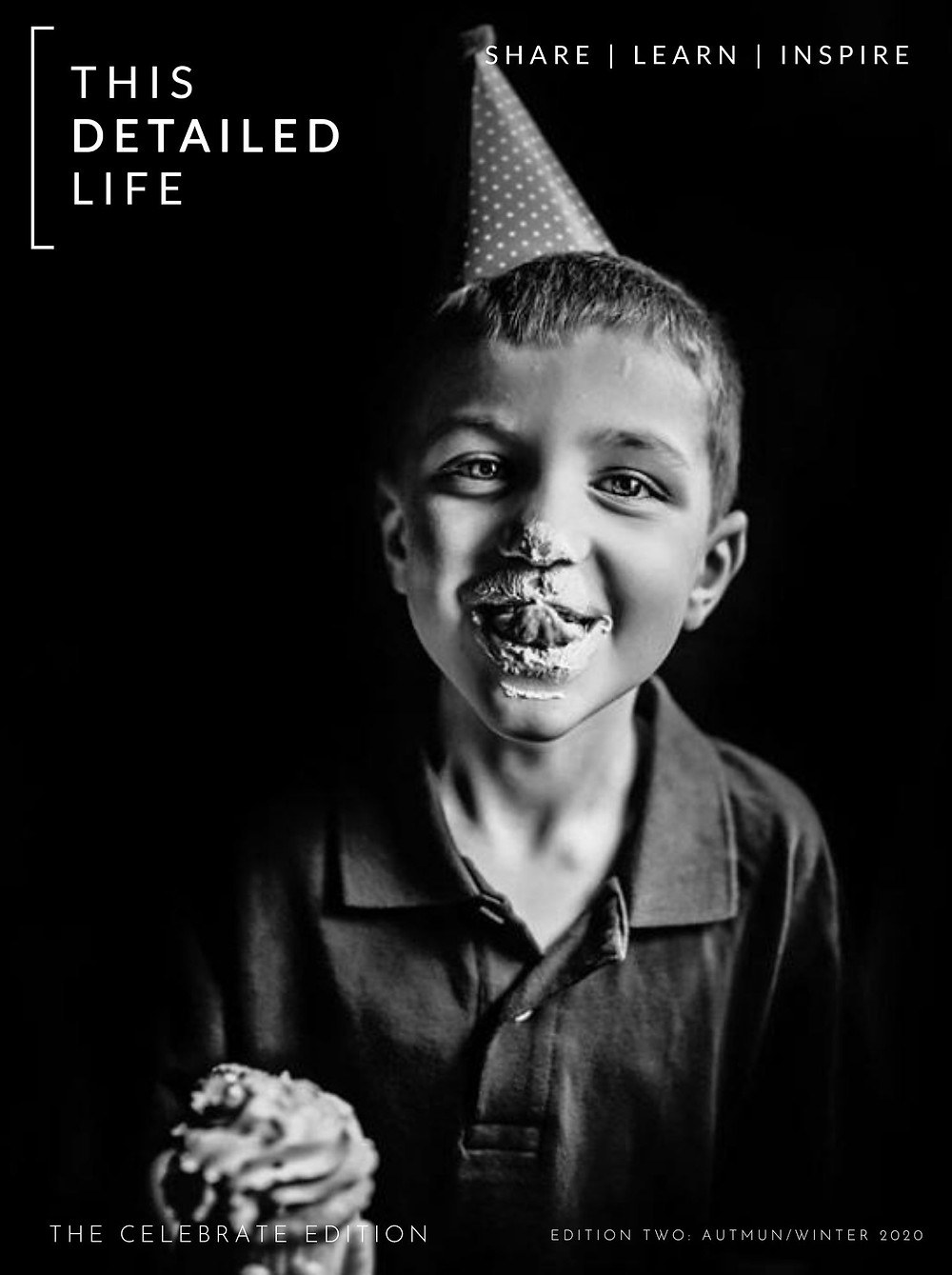 Boy celebrating birthday with party hat and cupcake