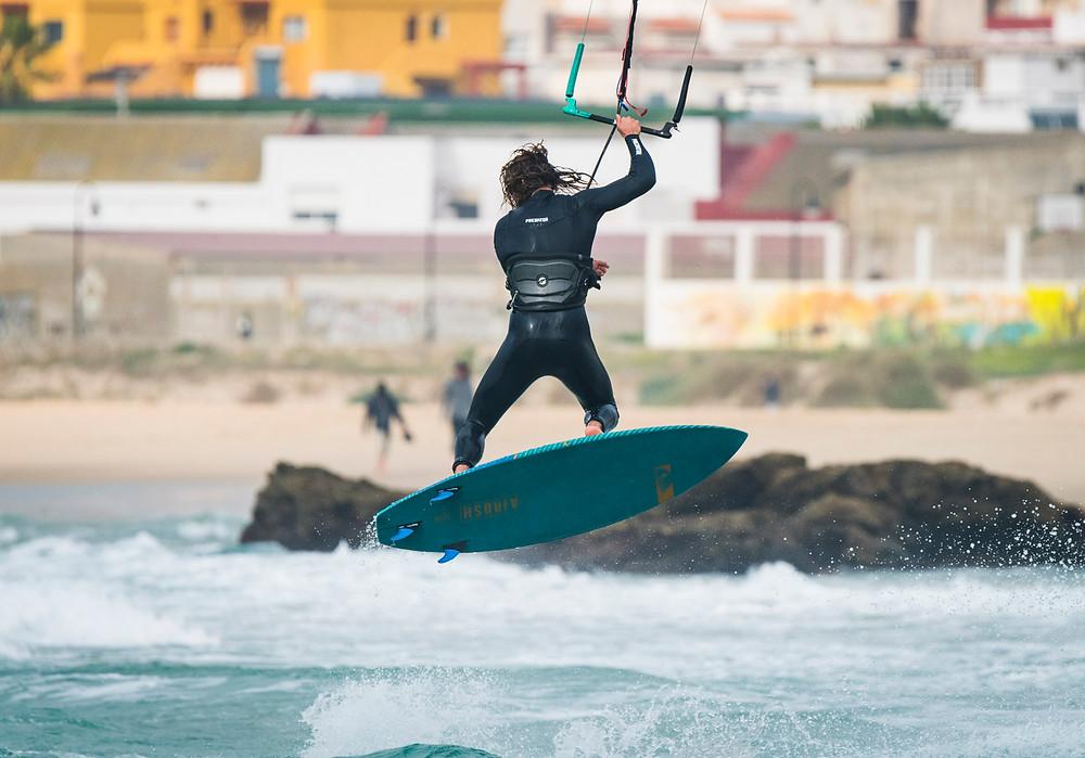 Strapless kitesurfing action. Tarifa, Cadiz, Andalusia, Southern Spain.