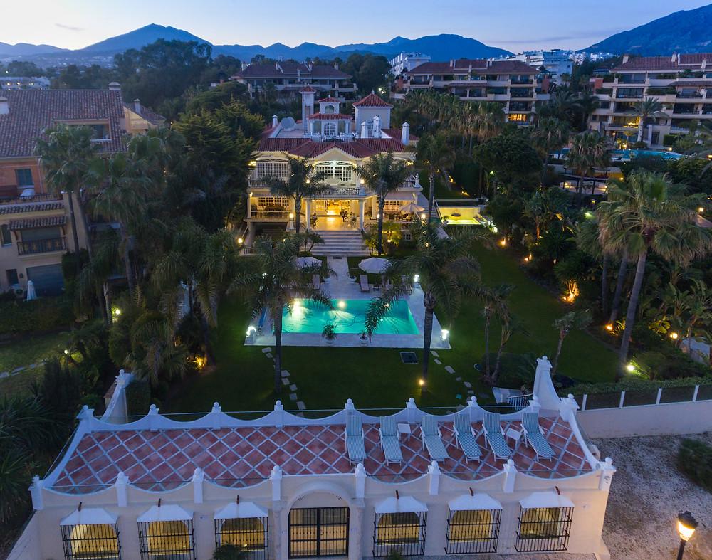 The luxury property at dusk.