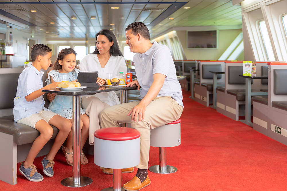 A family in the restaurant of the ferry.