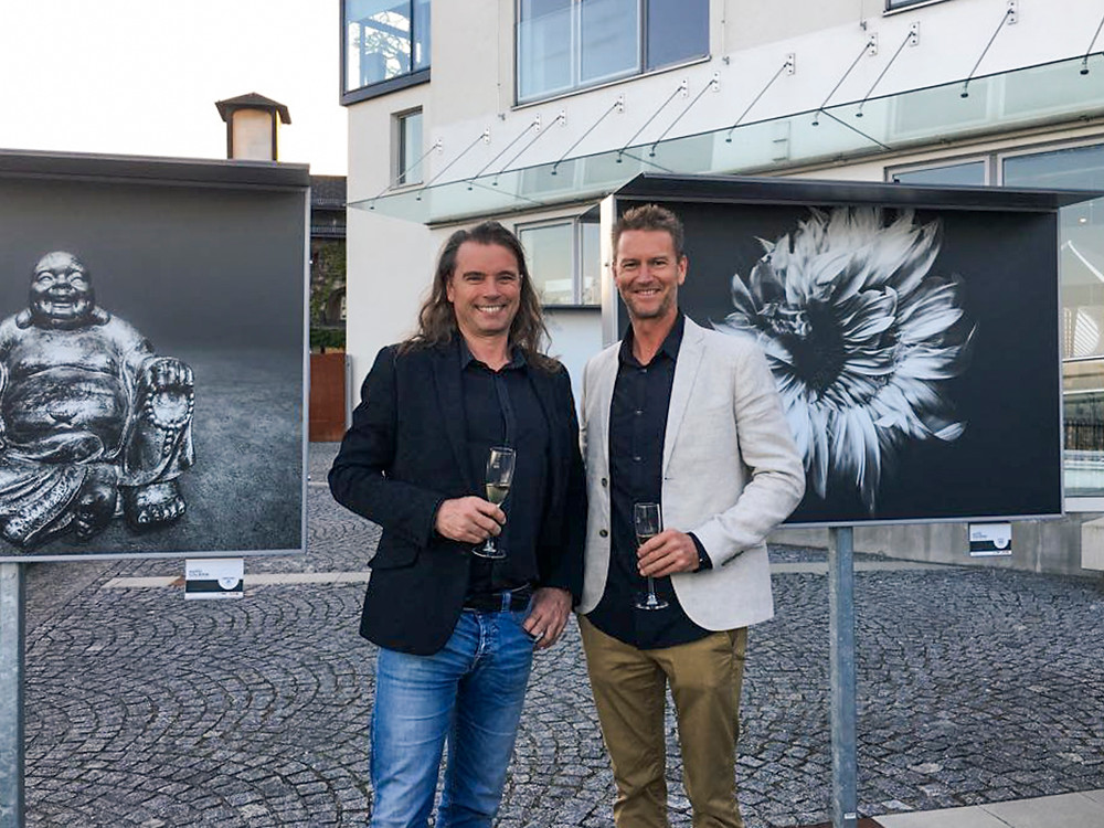 Ben Welsh next to chairman, Chris Hinterobemaier, at his photo art gallery in Linz, Austria.