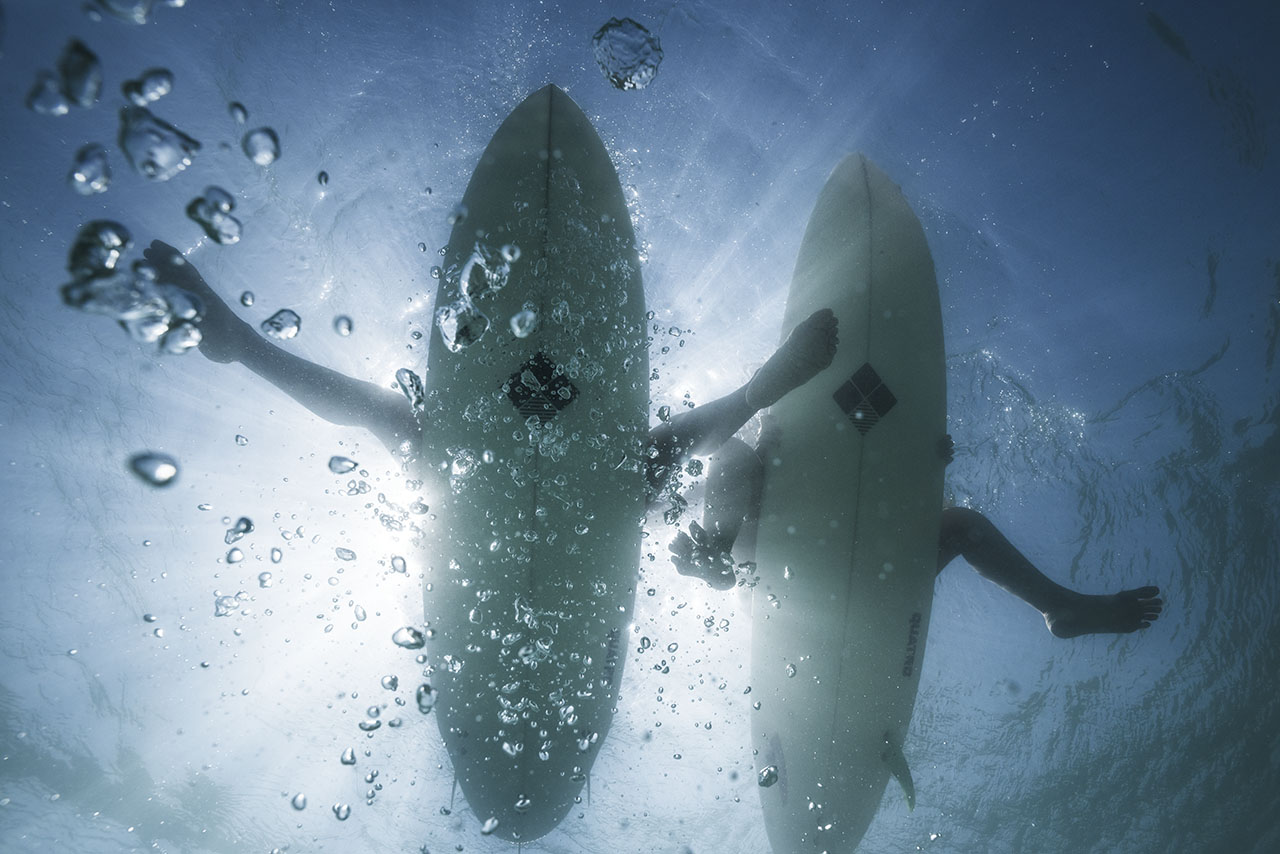 Surfers from a shark view.