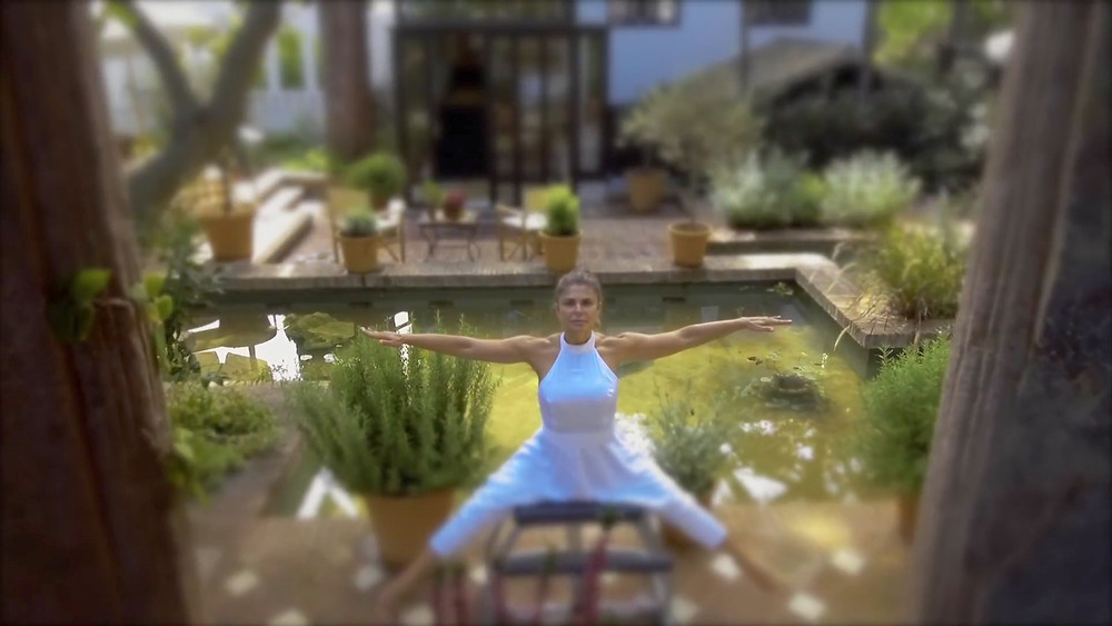 The pilates teacher practicing outdoors at the Marbella Club, Malaga, Andalusia, Southern Spain.