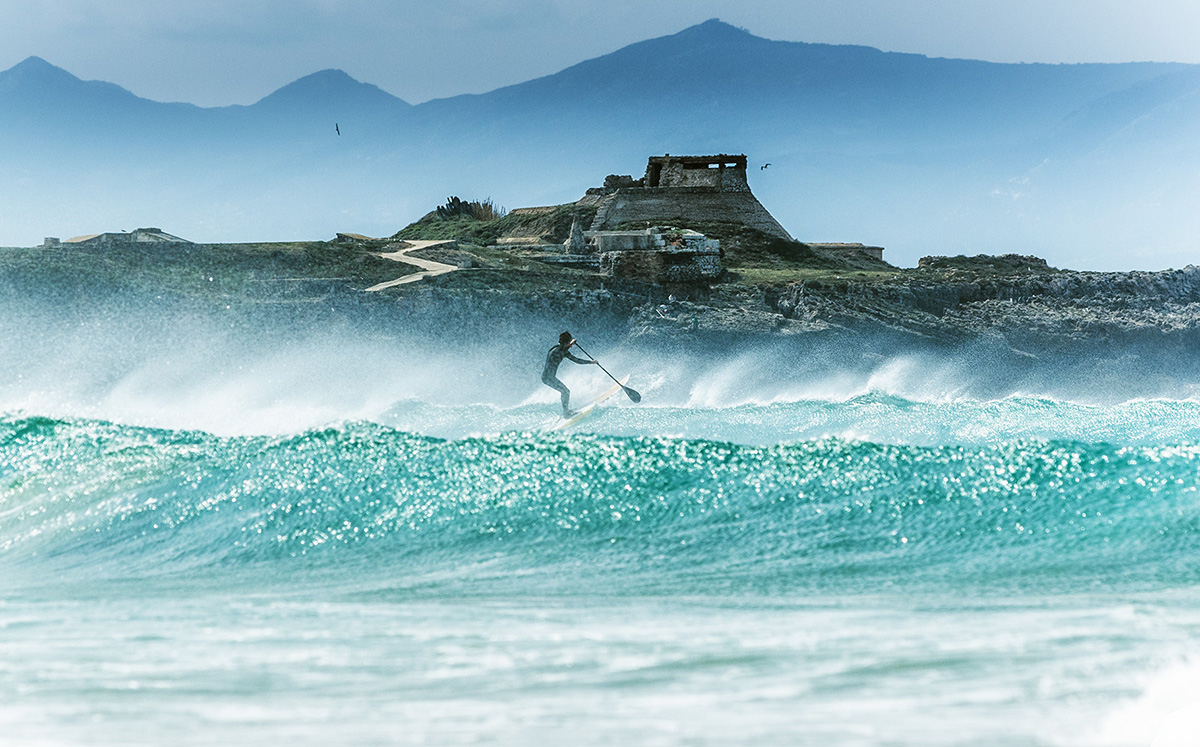 Paddle surfing in Tarifa, Spain.