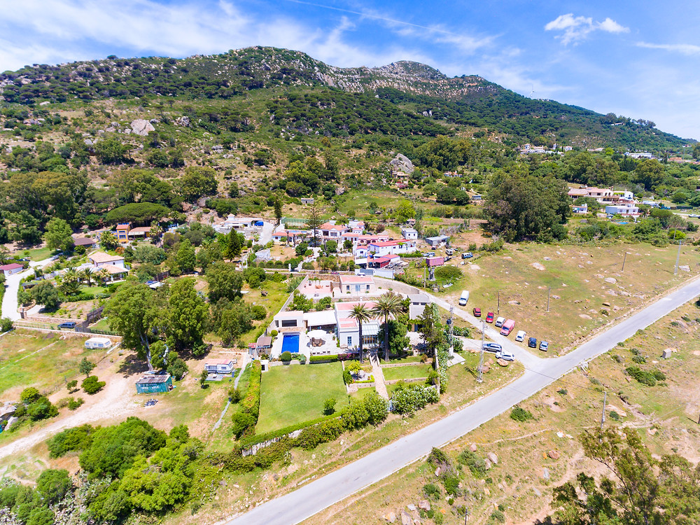 Drone view of the property and the mountain behind.
