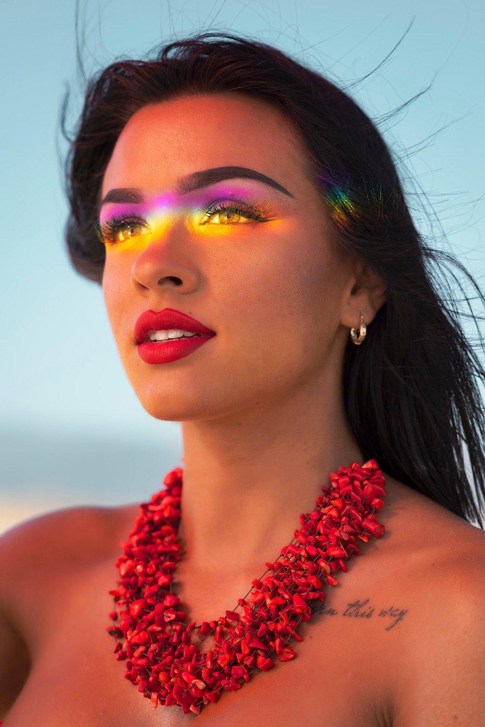 Rainbow colours shinning in the models face. The perfect beauty portrait by Ben Welsh.