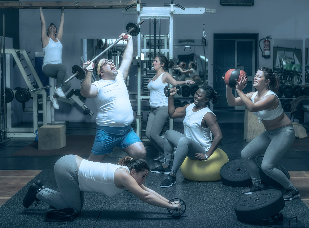 Normal people doing exercise at the gym.