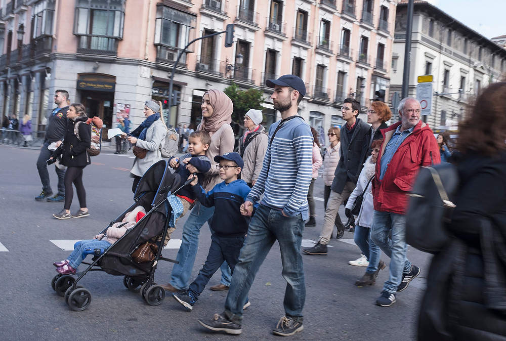 All types of tourists in the streets of Madrid.