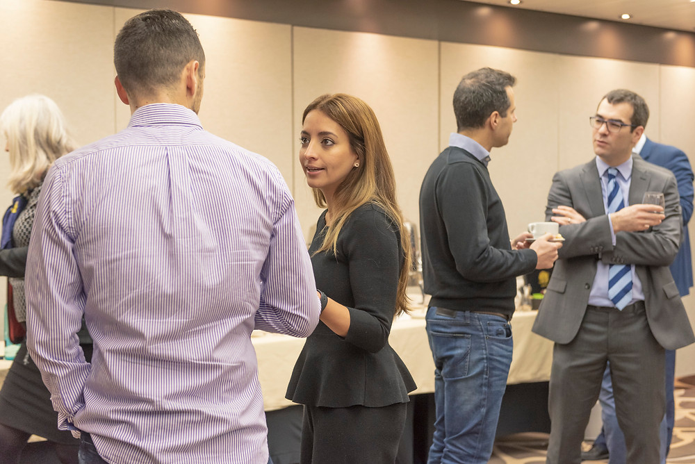 Members of the event networking during a break.