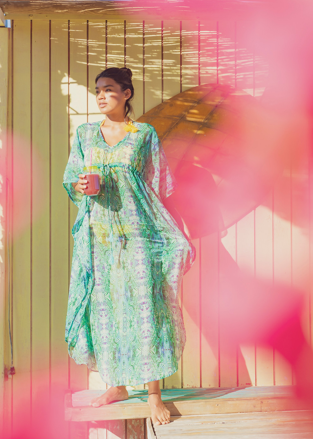 A summer dress in a exotic location. Photographer Ben Welsh mixed colours for a dreamy feeling.