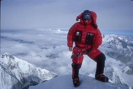Mountaineer on Summit of Mount Everest