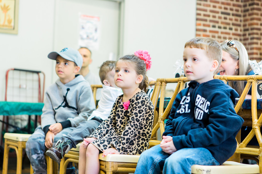 kids watching animal show at zoo birthday party