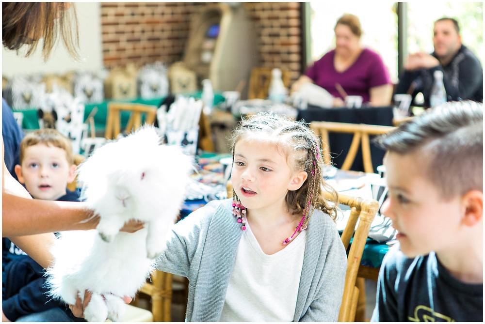 petting lionhead rabbit at zoo birthday party