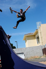 Kickflip to Indy skateboarding trick on the quarter pipe at a contest.  Invisiblesmiley (c)2020